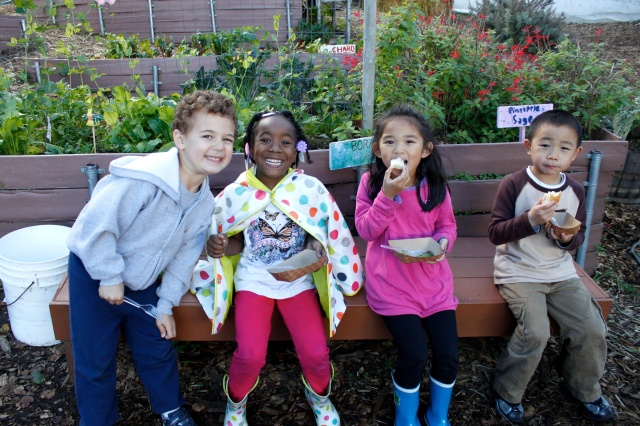 Kinders Eating Together in the Garden
