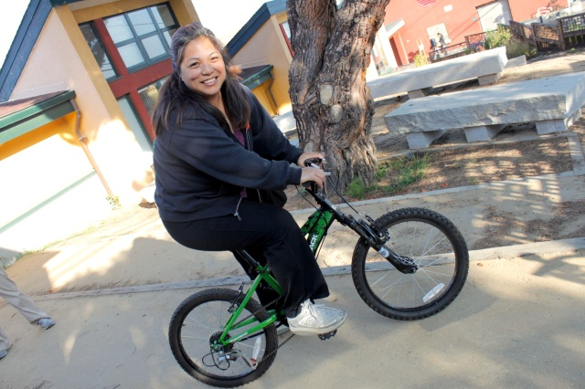 A Dedicated Parent Bikes to School when there is even no adult sized bike availalbe at home!