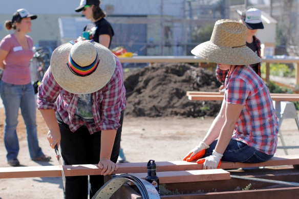 Xochi and Emma Working on the Frame (Photo By Patricia Fung)